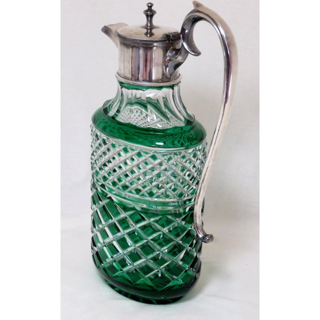 A fine quality Antique Wine Pitcher. Thick hand-cut overlay emerald green to clear crystal. Heavy Silver-Plate on Hard...