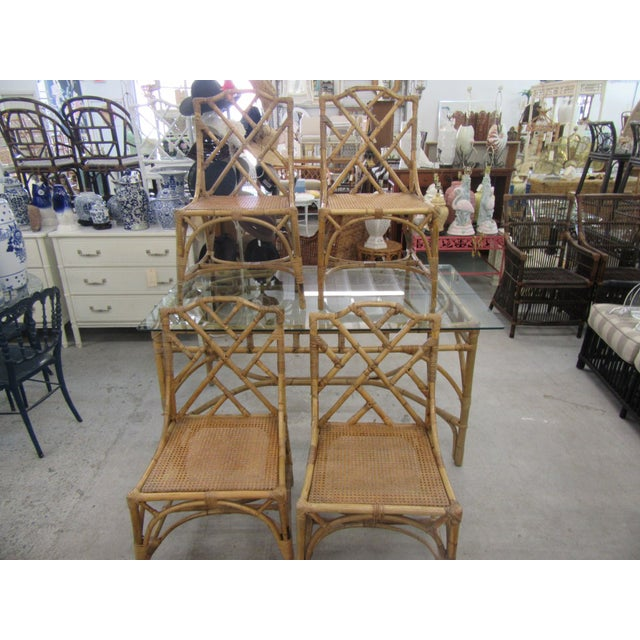"Bamboo Italian Deutch Chippendale Dining Set. It measures 30"" H x 60"" W x 36"" D. It has a glass top and is in good as..."