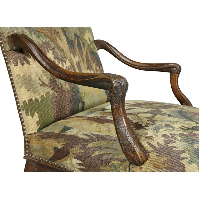 Antique armchair with serpentine crest-rail, carved molded arms, raised on carved cabriole legs with X stretcher and hoof...