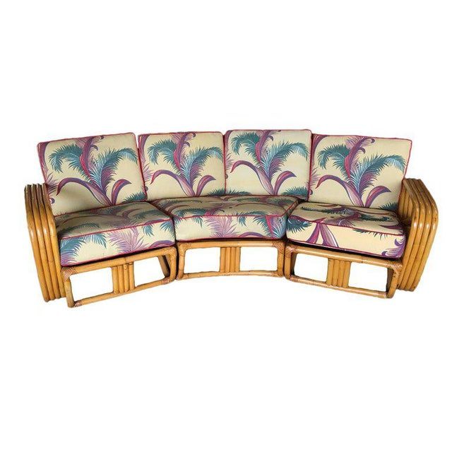 Four strand square pretzel Corner rattan sectional sofa designed in the manner of Paul Frankl. This sofa features a bent...