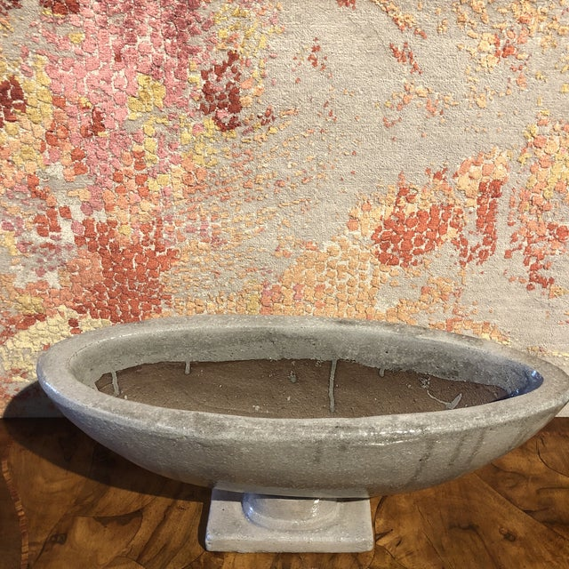 Boat shaped ceramic glazed grey, the tabletop urn with pedestal.