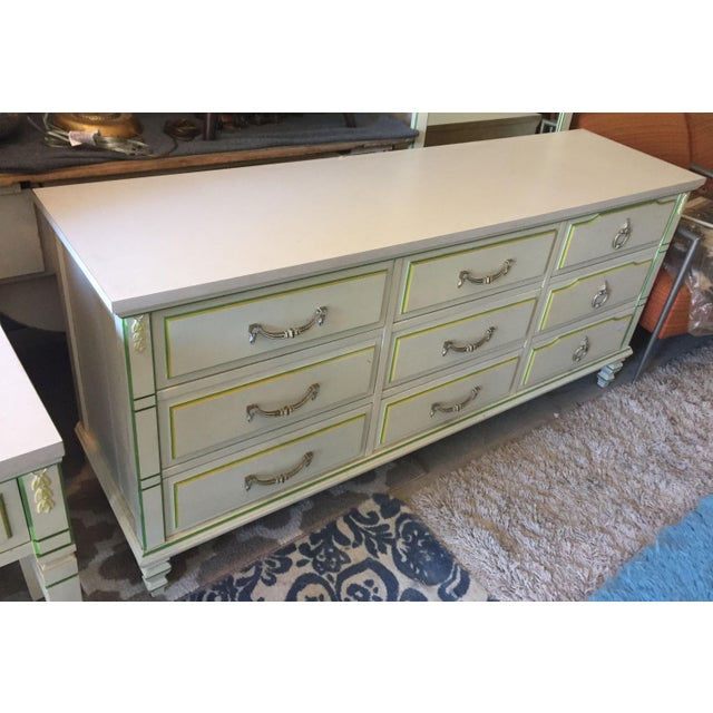 This Beautiful and Delicate original 9-drawerMid-century Modern lowboy dresser with Mirror, It dates back to the 1950's,...