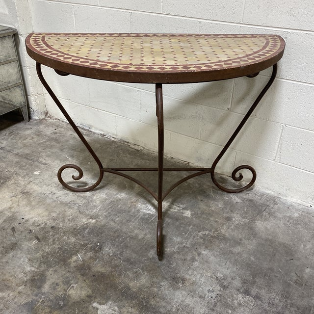 Beautiful little console handmade of solid iron and the top is a mosaic tile in a terracotta color inset in an iron from....