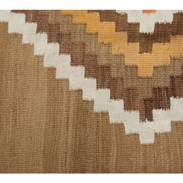 An early 20th century Persian Kelardasht Kilim runner with all-over multicolored diamond pattern on a natural wool...