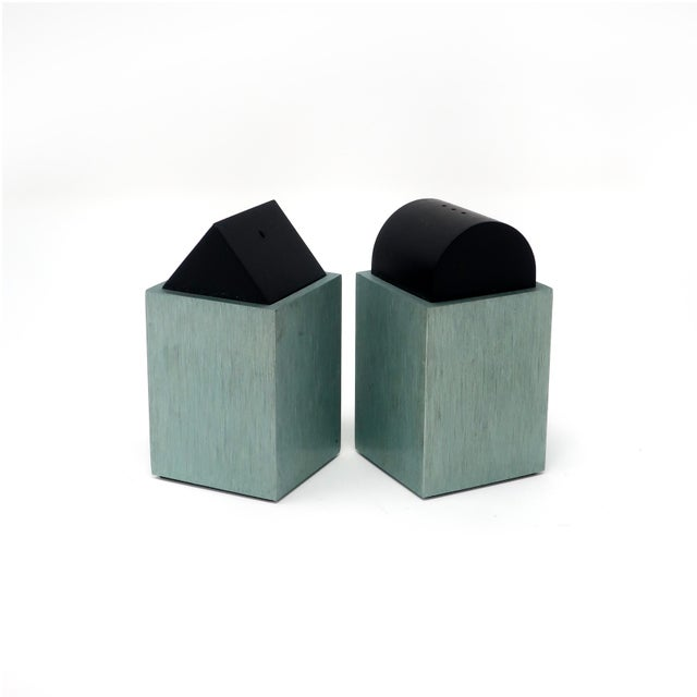 A lovely pair of post modern, Memphis inspired salt & pepper shakers by David Tisdale for Elika. Both are a pale green...