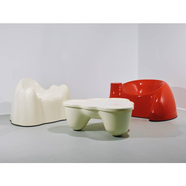 Wendell Castle armchair. USA, 1969 Fiberglass with rubber trim to base Measures: 42 W x 36 D x 24 H inches. Castle chair...
