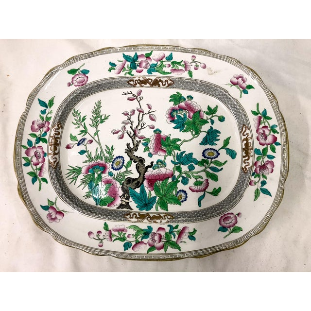 Late 19th century English transferware platter with vibrant pink and green florals. It is marked on the underside and in...