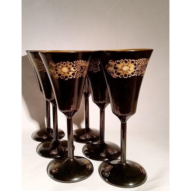 Japanese Black & Gilt Lacquer 6 piece Sake / Wine Glass Set. It is in very good condition. The glasses are not scratched...