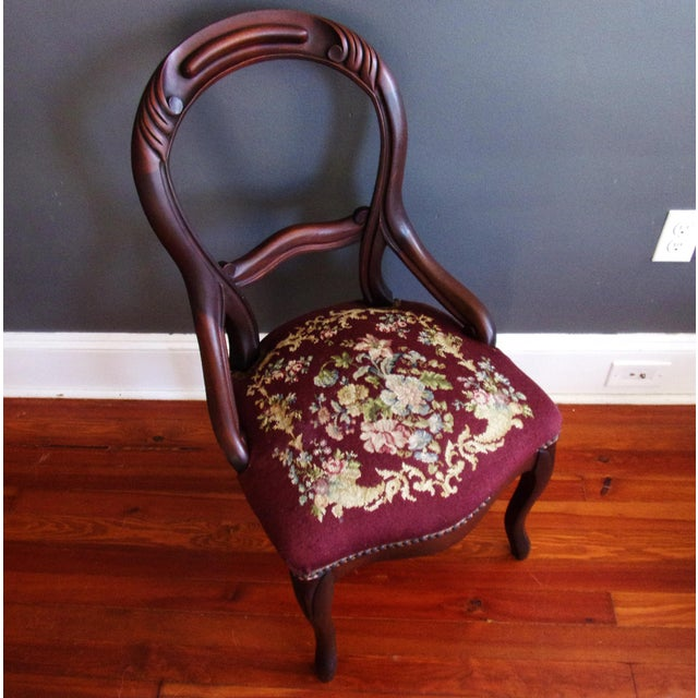 . Antique Victorian balloon back side chair . Carved, solid mahogany . Circa 1880s . Original tapestry floral...