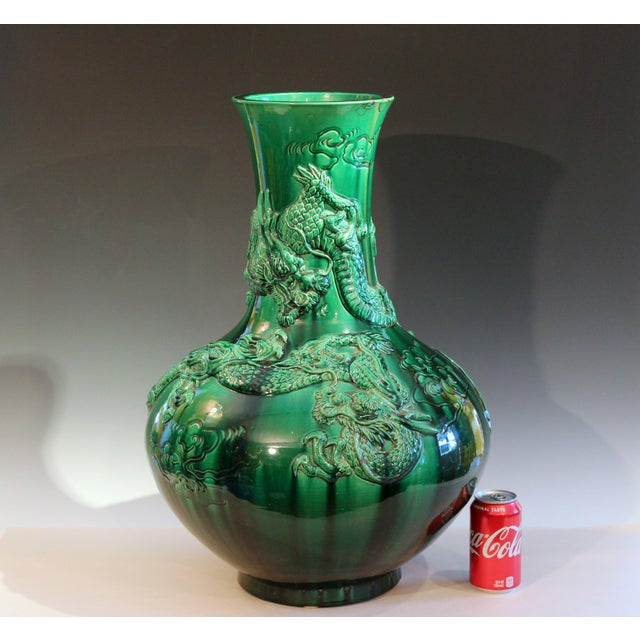 Large antique Awaji Pottery dragon vase, circa 1910. In bottle form with pair of sprigged dragons in relief on a green...