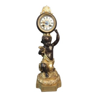 Figural Doré and Patinated Bronze Putti Ball Clock For Sale