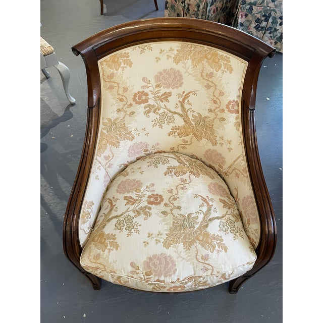 This is a gorgeous contemporary accent chair. The mahogany wood is such a great contrast to the light floral fabric. The...
