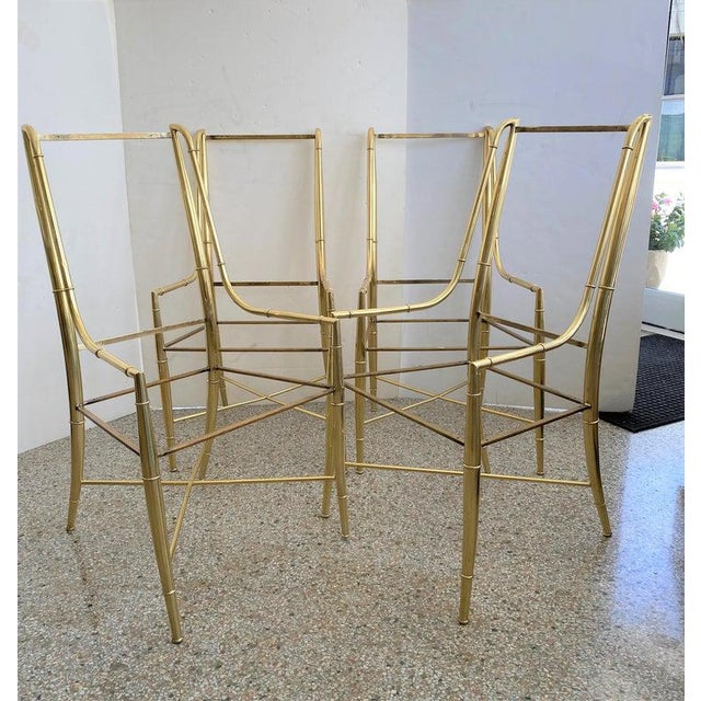 """This stylish set of ten brass """"Imperial"""" dining chairs were designed by Weiman/Warren Lloyd for Mastercraft and date to..."""