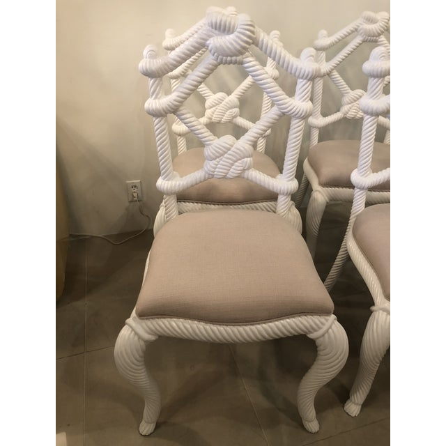 The most amazing set of four side dining chairs. Solid wood, heavy, sturdy rope nautical beach chairs. Newly lacquered in...
