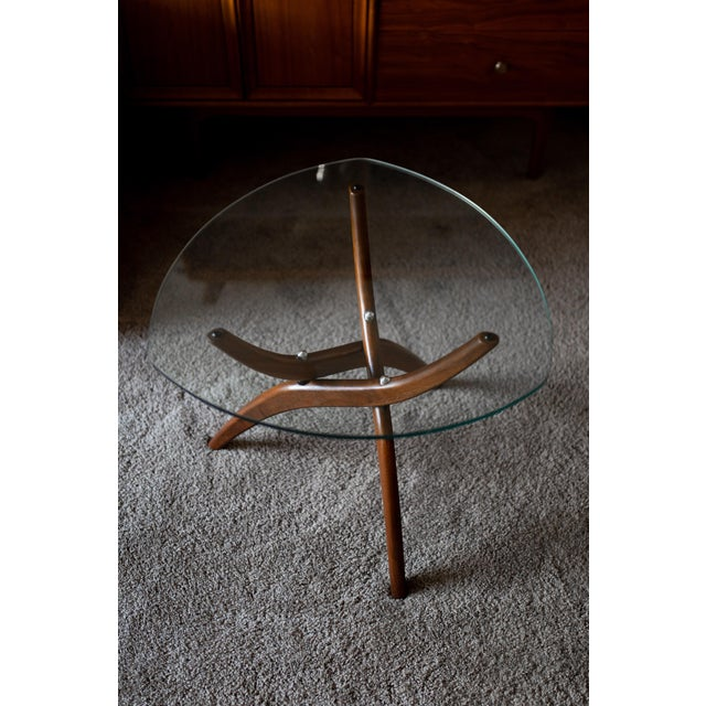 This is a gorgeous and elegant end table, with a sculptural walnut base and triangular glass top, by Forest Wilson, circa...