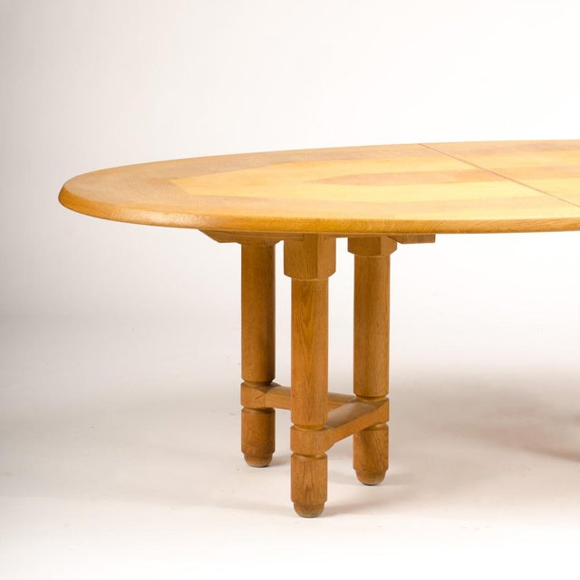 """A Guillerme et Chambron """"extendable"""" dining room table in solid oak with one additional leaf. The sculptural base has..."""