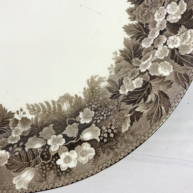 19th c. English Wedgwood transferware on creamware charger. Brown floral pattern with bluebells. Makers mark on underside.
