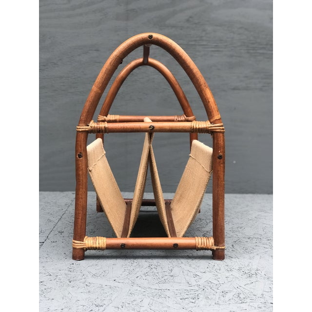 Mid Century Bamboo Magazine Rack featuring a two pocket canvas sleeve in excellent vintage condition!