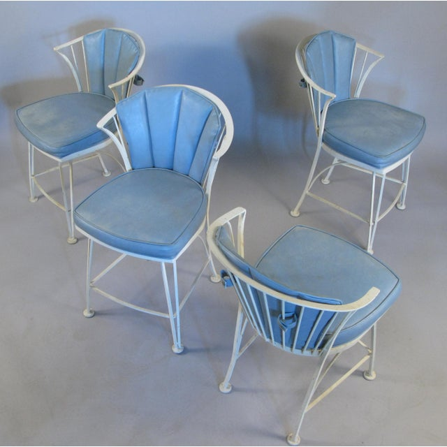 A set of four matched vintage 1960s Woodard Pinecrest chairs, with curved backs and their original vinyl covered seats and...