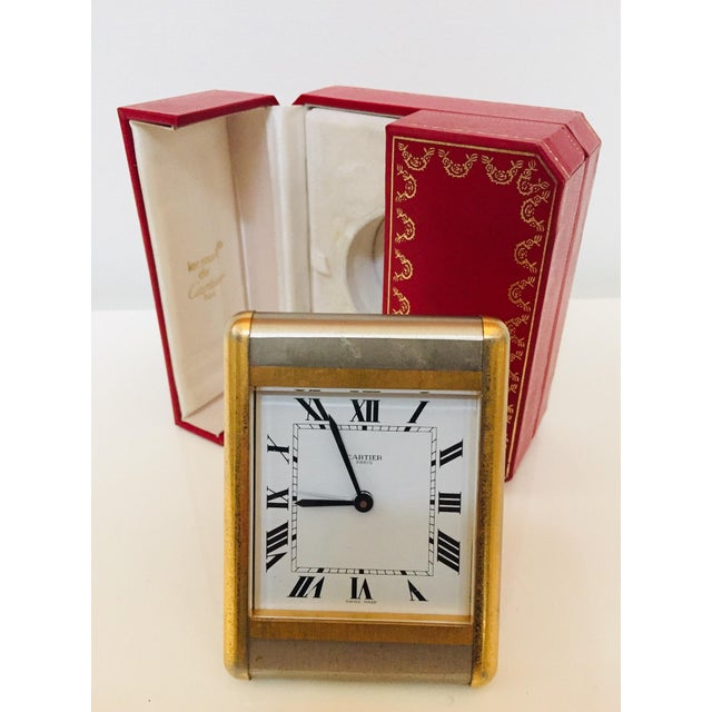 This is a circa 1980's original Cartier quartz alarm desk clock. The case is two-tone gold plated and steel and measures 3...