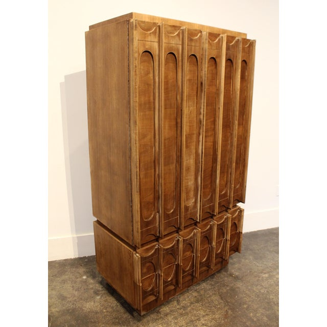 One-of-a-kind Brutalist 1970's two-piece wardrobe; stripped down to its natural walnut wood and refinished with a flat...
