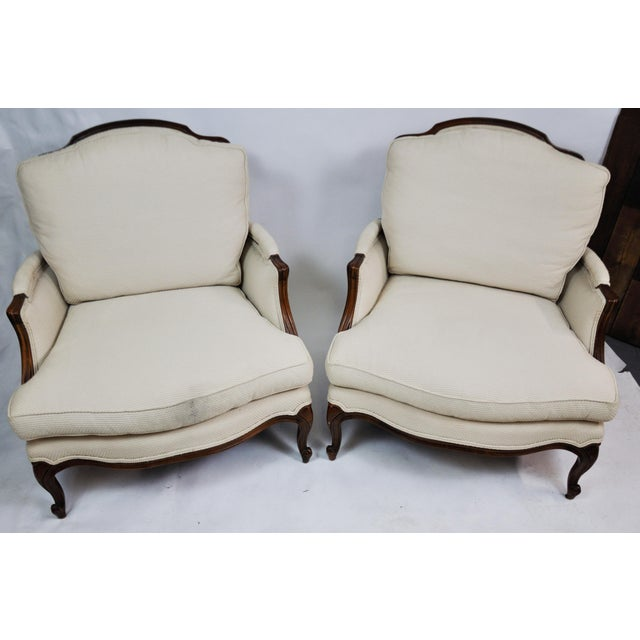 American/ Century Chair. Vintage Queen Anne Wingback chairs with carved cabriole legs and loose cushions. Oak wood. One of...