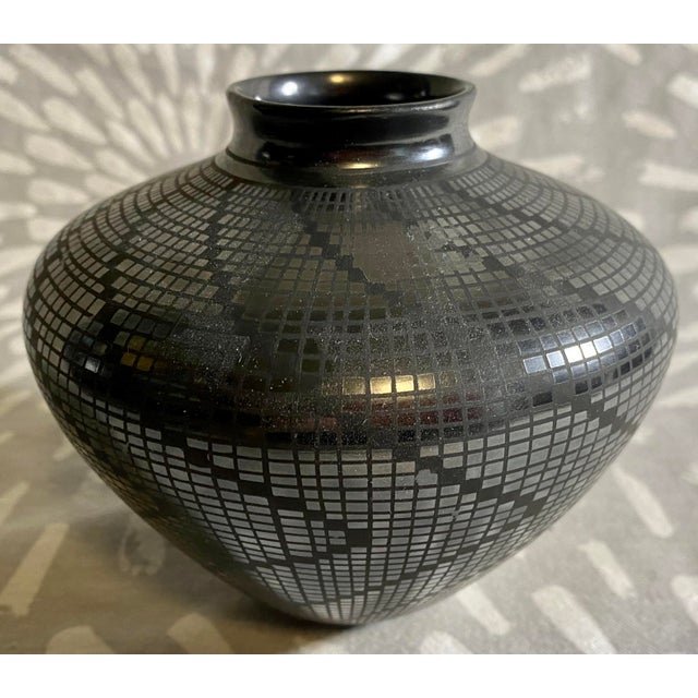 Beautiful black on black vase produced in the 1950s by Carolina Marin Gonzalez of Mexico. Vintage wear, marks and patina.