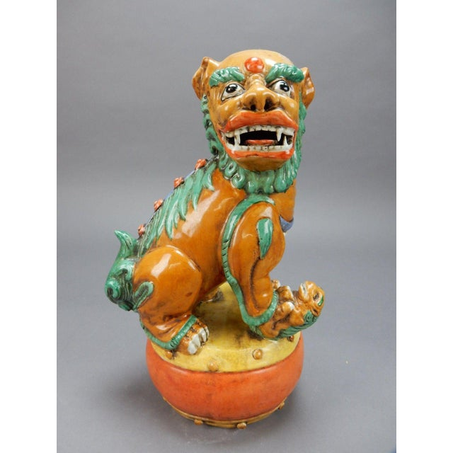 Gorgeous antique Chinese hand painted drip glazed Nan King female foo dog. Great colors and amazing details. Qian Long...
