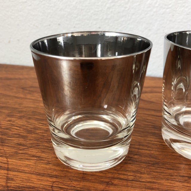 Four ombre mirrored glasses. Would be a great addition to any bar cart.