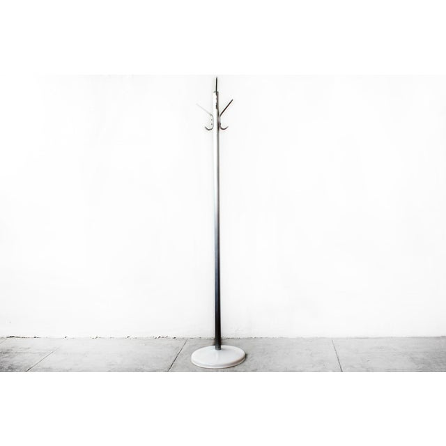 This elegant 1960s steel coat rack features a brushed aluminum body with a steel base, newly powder coated in gloss white....