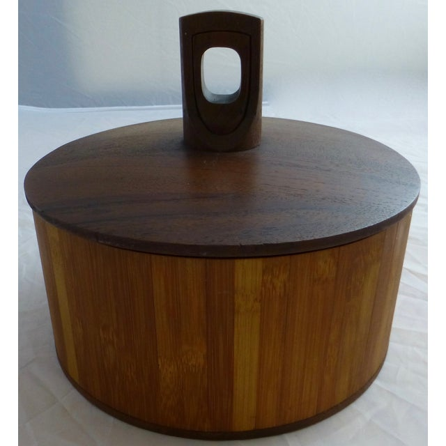 We love this unusual Dansk ice bucket that features a teak wood handle, black plastic, and the entire inside spins!...