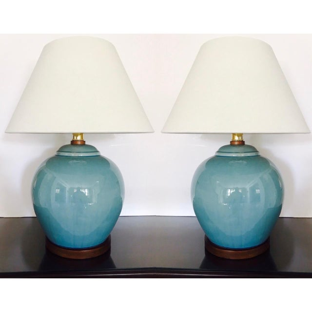 Gorgeous pair of large ceramic pottery lamps in Robin's Egg Blue. The lamps feature a crackle glaze finish with hand-...