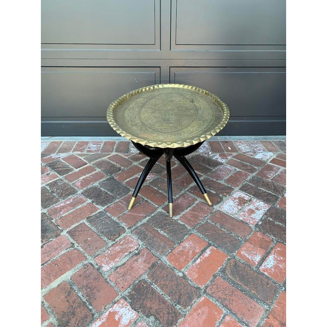 Mid Century Modern Morrocan Two Piece Brass and Ebony 6 Legged Sipder Oval Coffee Table with sabot feet detail. Designer...
