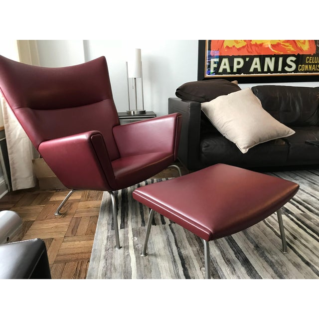 Contemporary Hans J. Wegner for Carl Hansen & Søn Burgundy Wingback Chair and Ottoman For Sale - Image 3 of 11