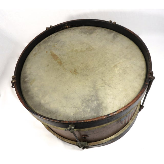 Antique birds eye maple parade marching drum with hand painted patriotic U. S. red white & blue shield. Circa 1900. Being...
