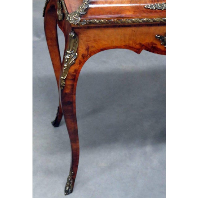 Louis XV style inlaid cellarette with bronze mounts and metal insert.