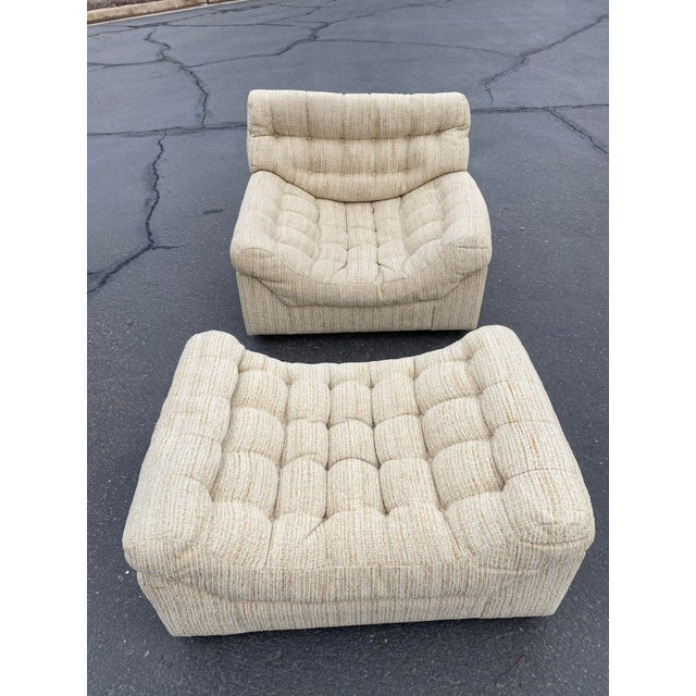 The Tommy Tufted lounge chair is a modern classic. Featuring scooped seating and an artful frame that boasts no straight...