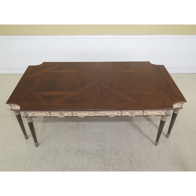 EJ Victor paint decorated regency dining room table. Features high quality construction, nice inlay work throughout and...