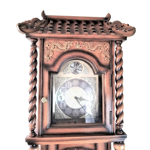 Vintage Chinese Highly Carved Tempus Fugit Grandfather Clock A beautiful vintage Tempus Fugit Grandfather clock with an...