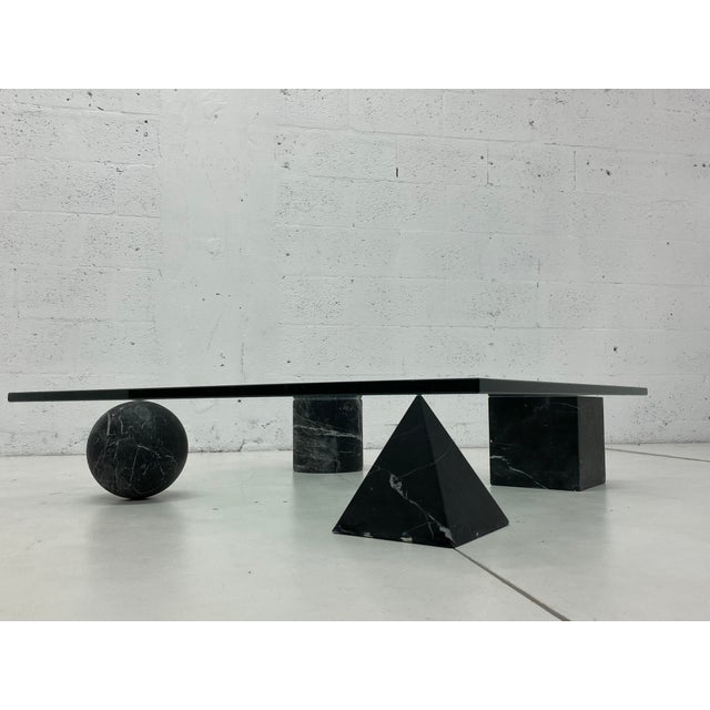 Metafora glass and matte black marble coffee table by Massimo and Lella Vignelli produced by Casigliani, Italy, circa...