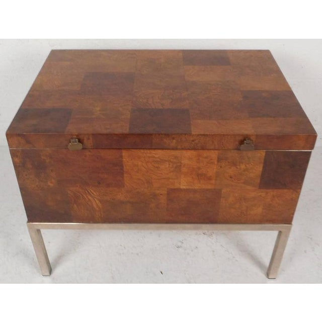 This beautiful vintage modern chest features a flip-top with unusual brass pulls that opens up to a large compartment....