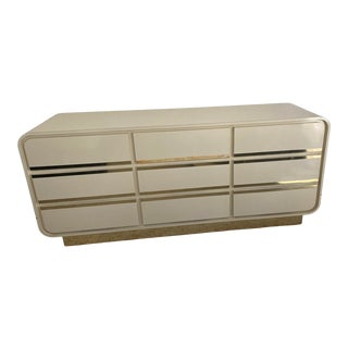 1980s Postmodern Cream Laminate 9 Drawer Dresser With Rounded Edges and Brass Accents For Sale