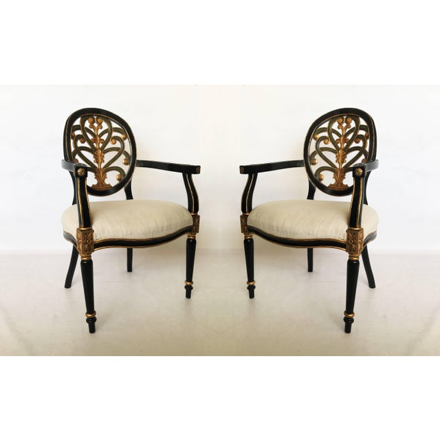 Lacquer and gilt carved Sheraton style pair armchairs with an open oval back, the splat with decorative gilded...