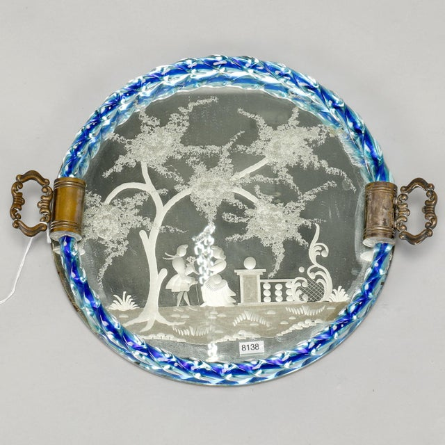 Round Venetian mirrored dresser tray with cast brass handles, blue twisted glass rim and an etched Provincial scene, circa...