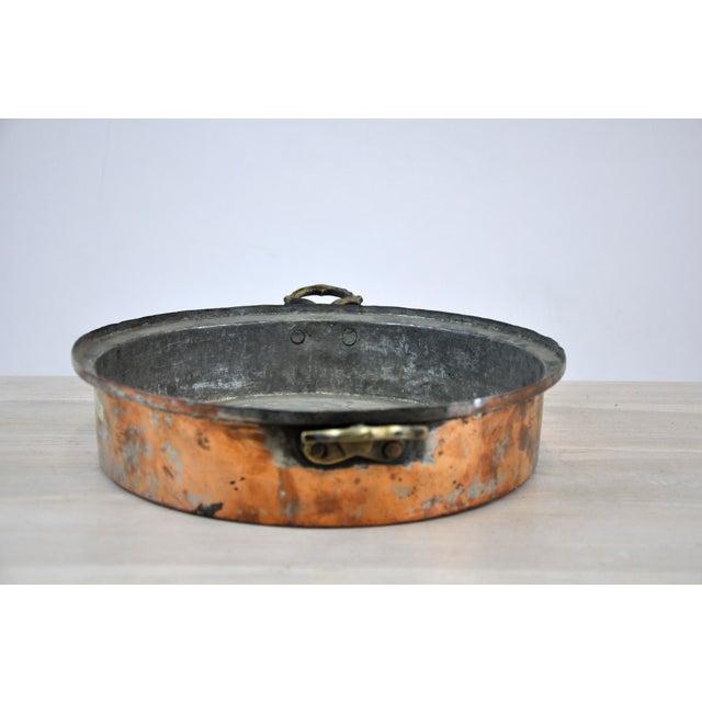 """Oval Antique Copper Bowl Decorative Planter. Iron handles. Dimensions: W 13"""" x D 13"""" x H 3"""""""