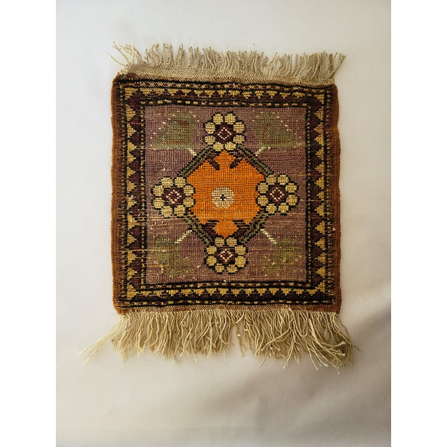 Beautiful vintage wall hanging, hand woven in muted colors. This piece has a gorgeous sophisticated color palette and...