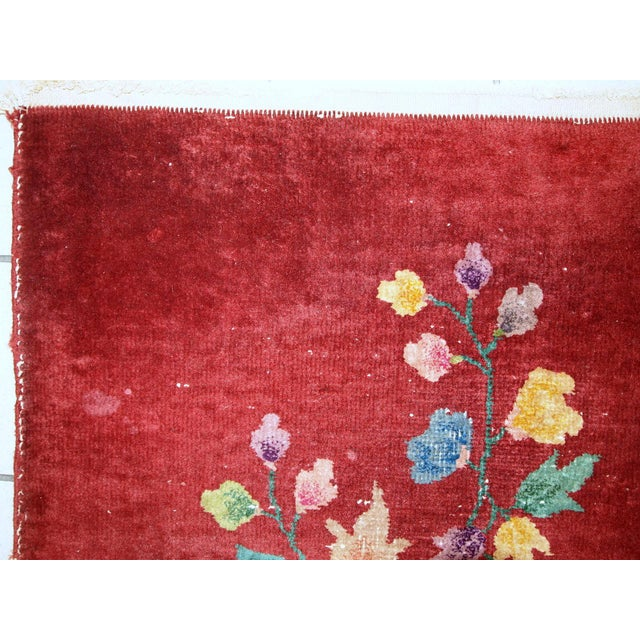 Antique Art Deco Chinese rug in original condition. The rug is in a bright orange color. Decorative floral design in...