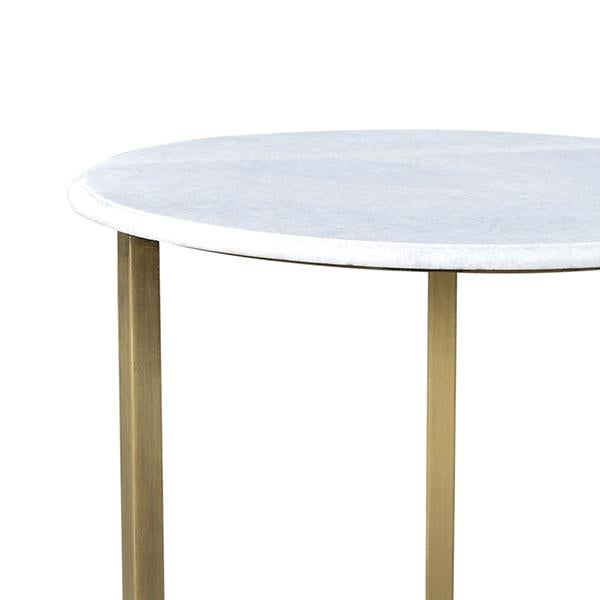 Beautiful modern chic design. This side table features a white marble top with brass finish legs. Each unique.