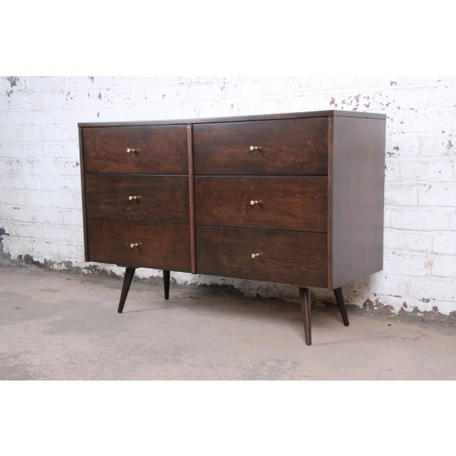 A stunning mid-century modern six-drawer dresser designed by Paul McCobb for his Planner group line for Winchendon...