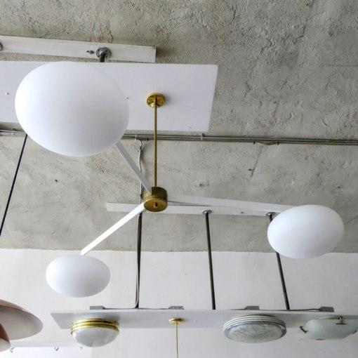 Stunning large-scale three-arm chandelier by Gallery L7, in white enameled steel with brass accents and three matte...
